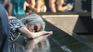 Mija Quigley of Princeton Junction, New Jersey, embraces the name of son Patrick Quigley at the 9/11 Memorial on September 11.