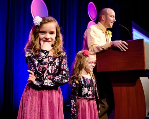 The girls sharing the spotlight with daddy at his Teacher of the Year acceptance speech. For more, click here